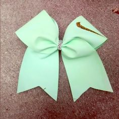 Nike cheer bow Mint green bow,gold Nike swoosh,well made, never worn . Nike Accessories Hair Accessories