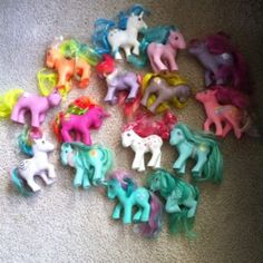 the 1980's My Little Ponies were so much cooler than the ones now! ... I am pretty sure that bright pink in the middle and the white one at the top are unis.