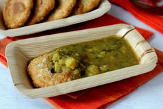 Aloo ki sabzi with kachori - an Indian street food potato curry served with a lentil stuffed deep fried snack. a gem among aloo recipes (potato based).