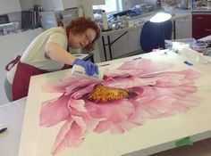 Really big pink flower painting.