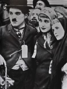 """with Edna Purviance & KItty Bradbury in """"The Immigrant"""" 1917."""