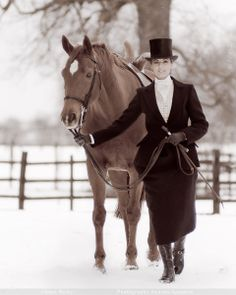 Side Saddle, lady dismounted and with her skirt buttoned up for walking.