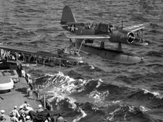 The number 2 OS2U Kingfisher launches from cruiser USS ASTORIA's port catapult, July 1944. These planes ferried officers and carried mail to and from the island of Trinidad. -photo taken by and courtesy of Herman Schnipper