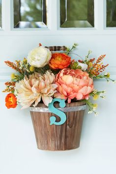 Welcome spring with a beautiful DIY floral arrangement personalized with your letter of choice.