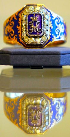 Queen's antique diamond and enamel bangle, which central plaque depicting diamond set cyrillic 'N' for Tsar Nicholas I.