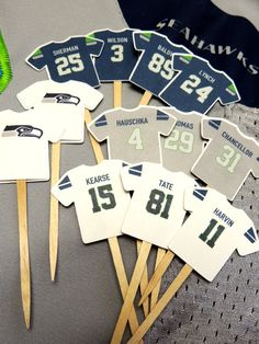 Should have ordered. These are ADORBS!!!Seattle Seahawks Cupcake Picks by Papelier on Etsy, $10.00