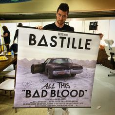 Dan Smith of Bastille holding a giant poster of Bad Blood Amazing Songs, Best Songs, Indie Music, My Music, Hole In My Soul, Kyle Simmons, Weird Songs, Dan Smith, Bad Blood