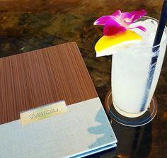 Featured on our Sunset Menu, the 'Lemongrass Collins' is created with Kai Lemongrass Ginger Shochu, Housemade Sweet and Sour, & Sparkling Water.  #TrumpWaikiki #Waikiki #Hawaii #Waiolu #HappyHour #Cocktail #Drink #Shochu