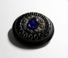 Black Bakelite Coat Button Floral by ButtonsFromTheAttic on Etsy, $22.00