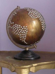 globe decorated with pins