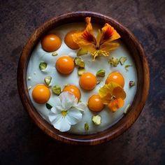 Matcha yogurt coconut bowl topped with husk cherries, crushed pistachios, nasturtium, & violas. ✅ By- @mississippivegan ✅  #ChefsOfInstagram @DessertMasters