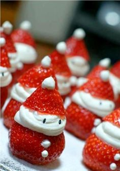 Cutest little strawberry santas. Healthy Christmas treats! They are made out of fresh strawberries, sweetened cream cheese and sesame seeds. :-)