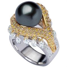 Bapalal Keshavlal - Gold ring with Southsea black pearl, white and fancy yellow diamonds.