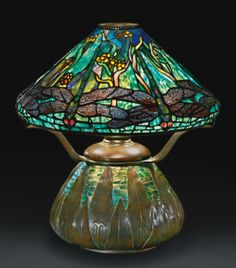 "Dragonfly and Waterflowers table lamp by Tiffany Studios, NY. Leaded glass, favrile mosaic glass and patinated bronze. Shade: the rare favrile mosaic glass ""Arrowhead"" base, Tiffany Stained Glass, Stained Glass Lamps, Tiffany Glass, Leaded Glass, Mosaic Glass, Glass Art, Fused Glass, Old Lamps, Antique Lamps"