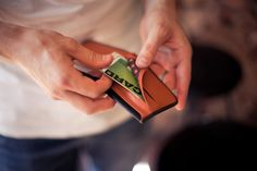 Bellroy - Hide and Seek. Holding all of the money and cards you could need, it helps separate items you use more often from those that are important but needed less. The unique hidden flap means large bills can be concealed from view, while the flat pack storage section helps stack away cards in a secure location. Hand crafted in India from vegetable tanned leather.