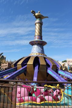 The riders in the front of the carpet on Magic Carpets of Aladdin control the height of the carpet. The ones in the back control the tilt of the carpet.