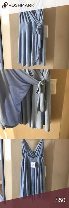 Sky blue spaghetti strap romper This is the most comfortable romper in the world. Light blue in color. Front cover to look like dress. Sits above the knee, tag still attached never been worn. Quality piece. Size extra small, true to size. Picture does not do justice. Urban Outfitters Dresses Mini