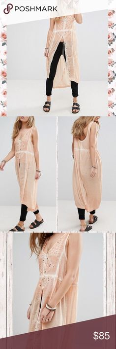 Free People Riptide Tunic Long maxi dress top NWT currently selling on the FP site for $92 gorgeously made of 100% viscose. Super soft and effortlessly feminine. A tassel-trimmed drawstring tie cinches the waist, openwork embroidery and a cool high/low hem. This is a really unique and versatile piece that you can layer and style in different ways. Happy to answer questions. Free People Tops Tunics