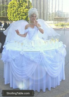 strolling tables with champagne on their skirts