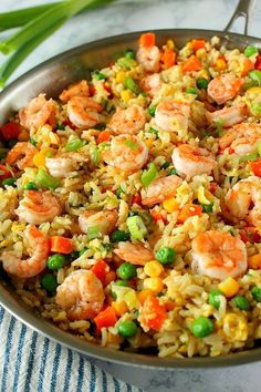 This Shrimp Fried Rice Recipe is the fastest and easiest takeout dinner you can make at home! You only need shrimp, leftover rice, frozen veggies, soy sauce and 15 minutes to turn it into delicious dinner. recipe with rice Easy Shrimp Fried Rice Recipe Shrimp Recipes For Dinner, Seafood Recipes, Chicken Recipes, Cooking Recipes, Shrimp And Rice Recipes, Frozen Shrimp Recipes, Fried Rice Recipes, Simple Shrimp Recipes, Prawn Recipes