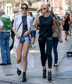 Can't get enough of each other: The besties were also pictured out and about in New York City on Thursday - Kendall rocking her long white coat and Hailey her cropped black skinny jeans