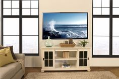 Our Bentley TV Stand, shown here in Country White, is available in your choice of wood and finish colors. Entertainment Furniture, Entertainment Center, Hardwood Furniture, Modern Furniture, Living Room Tv, Sliding Glass Door, Wood Species, Adjustable Shelving, Paint Colors