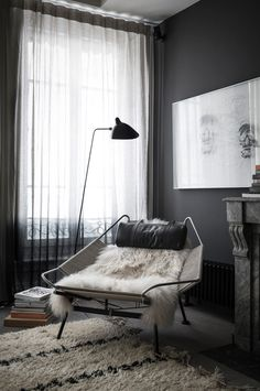 Grey themed lounge area. Relax in the fluffy grey arm chair and rug. Calming space. Romain Ricard | Photographe-Décoration-Voyages-Still Life #home #interior #design
