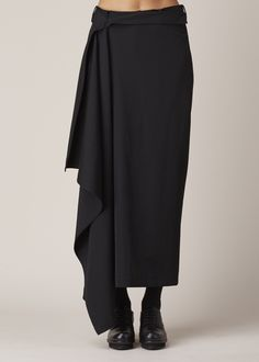 Slim wrap skirt with an adjustable, belted waist in black wool. Dry clean.