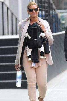 Beyonce and baby - from Marie Claire. Carrying little Blue Ive in a Baby Bjorn Baby Carrier Miracle - http://www.bambinodirect.co.uk/Baby_Bjorn_Miracle_Cotton_Mix_Baby_Carrier_-_Black-Silver_096065/version.asp
