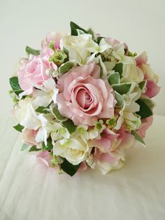 Sarah - A vintage style hand-tied posy of pastel pink roses, vanilla roses, pink/vanilla vintage style shaded hydrangea, stephanotis, waxflower and euonymus foliages. This particular bouquet is interspersed with faberge style sparkling pearls.  The handle is bound in vanilla satin ribbon with pearl pin decoration.