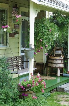 .Love it! crate planters, pulley for hanging plants, painted porch, swing, washer...