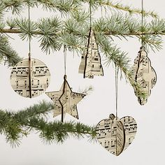 Sheet Music Christmas decorations - glue sheet music onto both sides of card stock, making 2 identical shapes.  Cut a slit in one half way up.  Cut a slit in the other half way down.  Slide one into the other.  Punch a small hole and attach ribbon or twine.