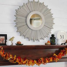 Add color to your mantel this fall with a #DIY leaf garland. More ways to decorate your mantel: http://www.bhg.com/thanksgiving/decorating/fall-mantel-decorating-ideas/?socsrc=bhgpin103112sunburstmirror#page=14