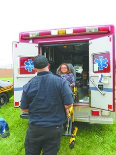 Mike Wright of North Star Critical Care showed Alannah Boyd what it is like to be loaded on a gurney and placed in an ambulance. Wright and Megan Oaks of North Star Critical Care were among the emergency response personnel who participated Saturday in the Calcutta Lions Club Safety Day at Calcutta Square. (Photo by Nancy Tullis)