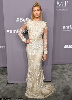 So gorgeous: Hailey Baldwin posed up a storm in an embroidered cream and white dress for t... #haileybaldwin #models #amfar