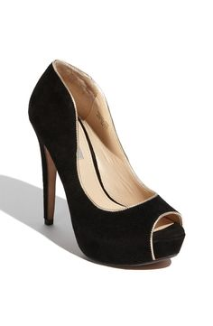 A peep-toe pump for fall is all the rage. We love the gold piping on these chic shoes from Classique Entier.