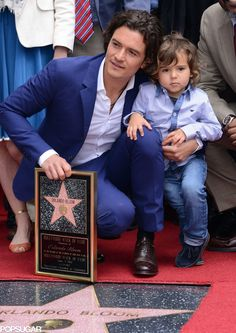 Orlando Bloom gets support from his son Flynn as he receives a star on the Hollywood Walk of Fame on April 2014 Orlando Bloom, Orlando Florida, Hollywood Walk Of Fame, Hollywood Stars, Orlando Vacation Packages, Daddy, Celebrity Moms, Celebrity Style, Lord