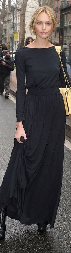Simple, elegant, long, knit black dress.  Could accessorize a million different ways for totally different looks from dressy to casual.  Love, love, love it.