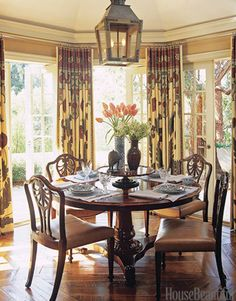 In his breakfast room, designer Michael S. Smith hangs Moghul Panel hemp curtains from the Jasper collection by Michael S. Smith. - HouseBeautiful.com