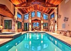 Wood and stone house with indoor pool. In my dreams!!