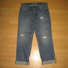"""Express Distressed Boyfriend Jeans These jeans are in excellent condition. Look practically still new. They are a button fly boyfriend style jean (no zipper) in a distressed medium/light wash. All distressing is factory made & intended. Made of 100% cotton. Tag size is 4. Inseam is approximately 28.5"""" long. Express Jeans Boyfriend"""