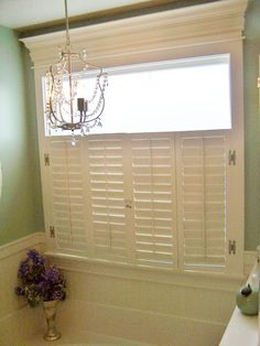Master bath tub area. LOVE this window treatment and chandelier.