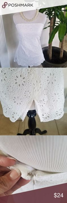 J Crew White scalloped crop top This adorable J crew White tiered eyelet crop top has a pretty scalloped hem is perfect for mixing and matching.  Womens Size 4.  This strapless crop is out of stock on the Jcrew site.  Definitely a must have. J. Crew Tops Crop Tops