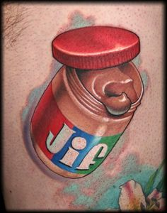 I am thinking a jar of Peanut Butter tattoo kind of like this one by Jeff Ensminger, but instead of Jif I will go with Peater Pan