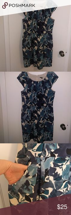 Floral cap sleeve dress with pockets! Blue floral cap sleeve dress with adorable pockets. Beautiful pleating on the neckline, and down the bodice. I'm 5'4 and it hits just above the knee. Slim fit skirt. Perfect for weddings or baptisms. Apt. 9 Dresses Mini