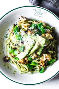 Roasted Cauliflower, Snap Pea, and Avocado Pasta with a Walnut Basil Pesto