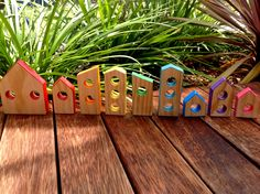 Rainbow mini wooden houses. Perfect way to use all our off cuts :)