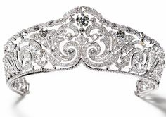 Diamond Bandeau Tiara: Created by Cartier in 1910 of diamonds set in platinum. Provenance: Queen Elisabeth of the Belgians; in 1912. King Leopold III of the Belgians; inherited from his mother in 1965. Princess Lilian of Rethy; inherited from her husband in 1983.