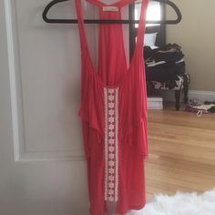 Loose tank top. Coral/pink color flowy tank top. Pretty flower design down the front middle. Lush Tops Tank Tops