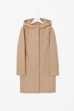 A clean, modern style, this hooded coat is made from panels of soft wool with a smooth interior. A straight shape, it has a hidden zip fastening, subtle in-seam pockets and two hidden press studs on the neckline.